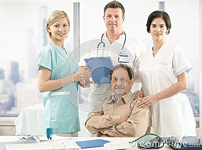Senior patient and medical team
