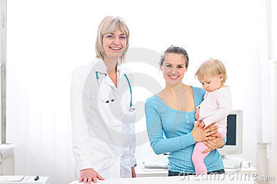 Senior pediatric doctor and mother with baby