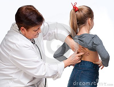 Senior pediatrician examing girl