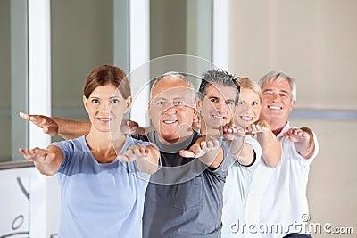 Senior people doing back exercises