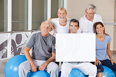 Senior people holding empty poster