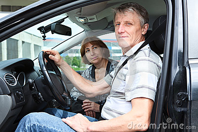 Senior people sitting in car