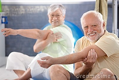 Senior people stretching