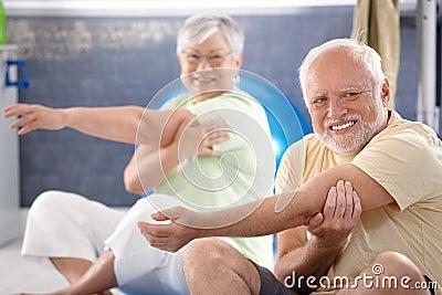 Senior people stretching