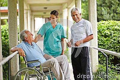 Senior people taking to nurse