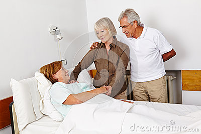 Senior people visiting bedridden