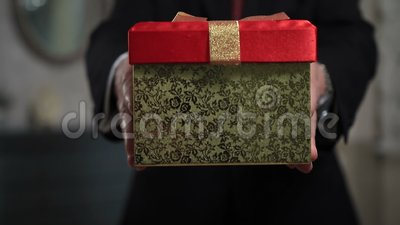 Senior person holding a gift pack stock video