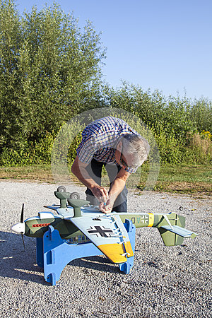 Senior RC modeller and his new plane model