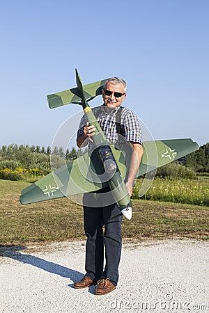 Senior RC modeller and his new plane model