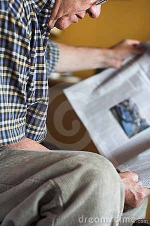 Senior Reading newspapers