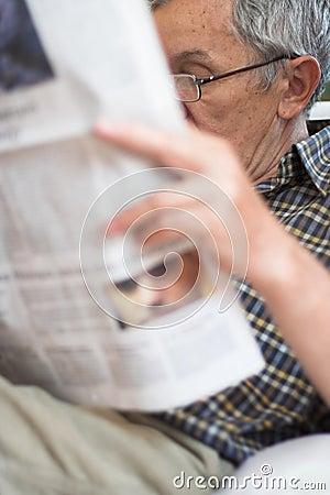 Senior Reading newspapers