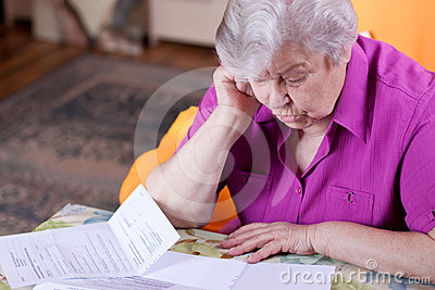 Senior reads papers and works hard