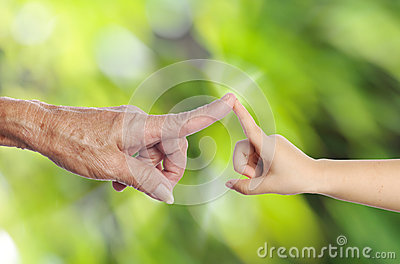 Senior s hand touching a child s hand