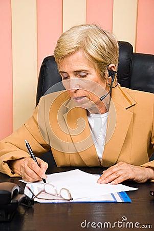 Senior sales representative taking notes