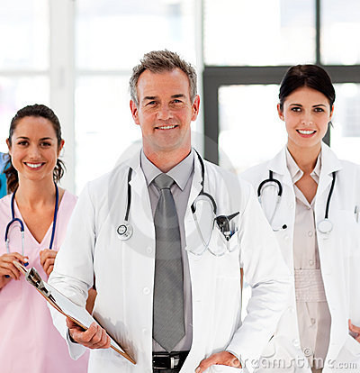 Free Senior Smiling Doctor With His Colleagues Royalty Free Stock Photography - 9840167