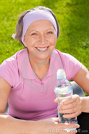 Senior sportive woman smile hold bottle water