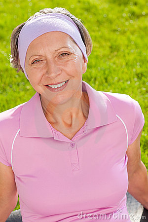 Senior sportive woman smiling outside portrait