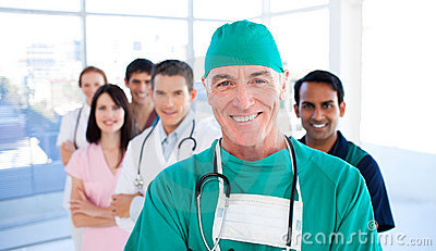 Senior surgeon standing with his colleagues
