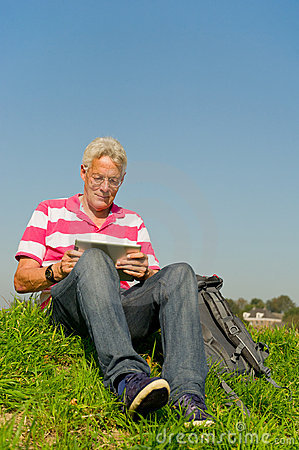Senior with tablet PC outdoor