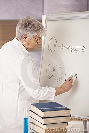 Senior teacher drawing molecular formulas