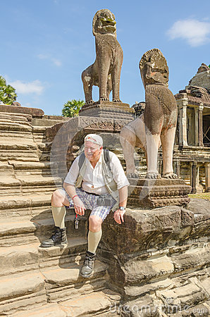 Senior tourist in Angkor Wat complex