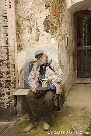 Senior tourist sit on a bench