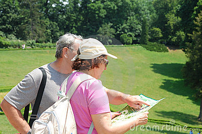 Senior tourists with map