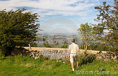Senior viewing over Winchcombe from Belas Nap