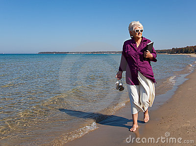 Senior Walking on the Beach Horizontal