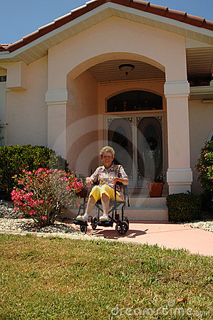 Senior in wheelchair at home
