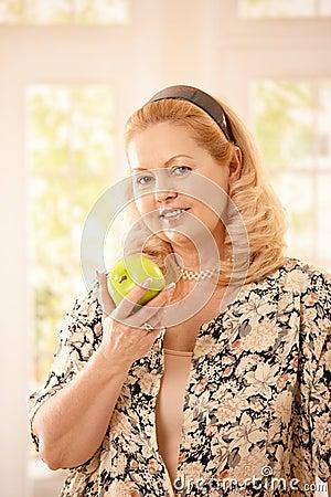 Senior woman with apple