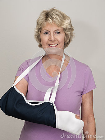 Senior woman with arm in cast and sling