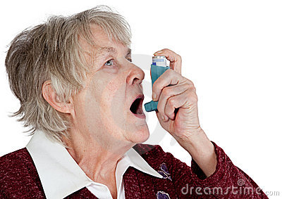 Senior woman with asthma inhaler
