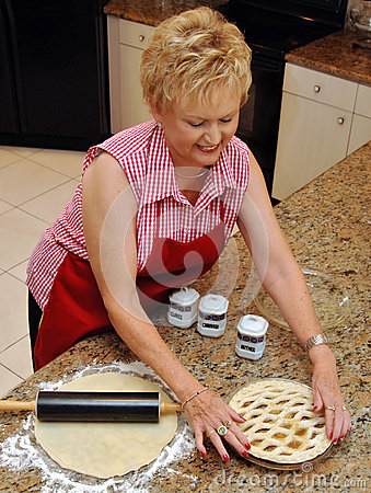 Senior woman baking pie