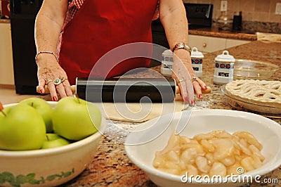 Senior woman baking pie