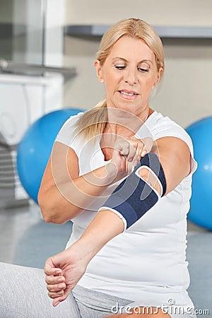 Senior woman with bandage on elbow