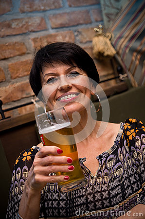 Senior woman with beer