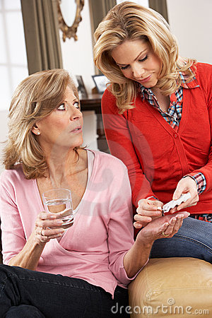 Senior Woman Being Helped With Medication