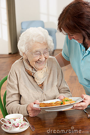 Senior Woman Being Served Meal