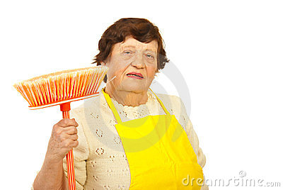 Senior woman with broom