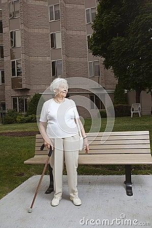 Senior woman at a bus stop
