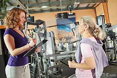 Senior woman on cable machine
