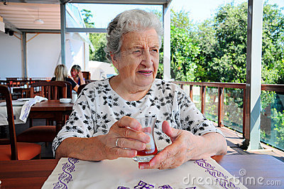 Senior woman at cafe