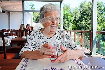 Senior woman at cafe