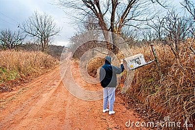 Senior Woman Checking for Mail at a Rural Mail Box