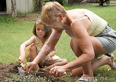 Senior woman and child gardening