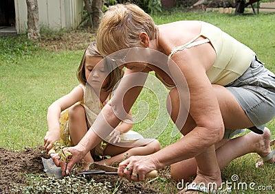 Senior woman and child gardening