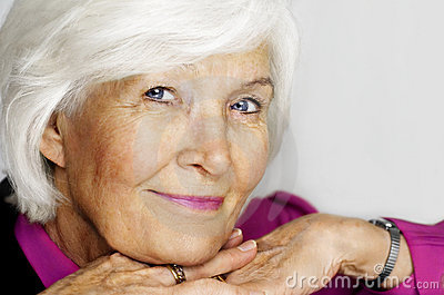 Senior woman chin on hands