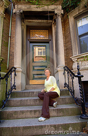Senior woman on city apartment steps
