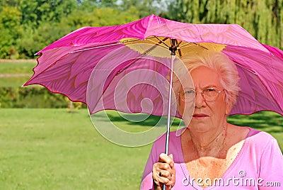 Senior woman with colorful umbrella